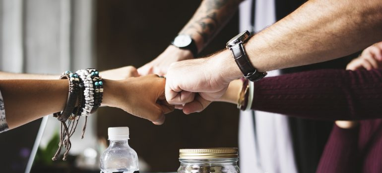 commercial movers Cairns - team members' fist bump