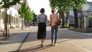 Two people walking.