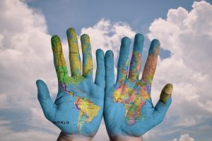 Hands with painted world map